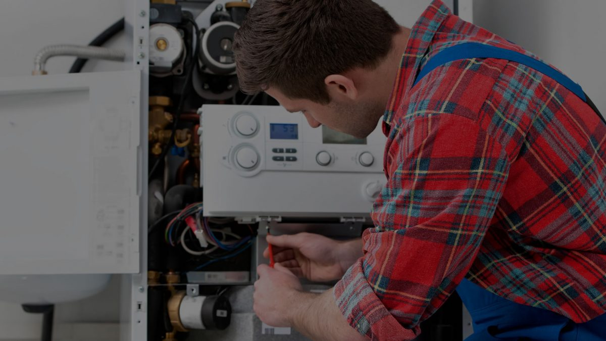 Man carrying out boiler service