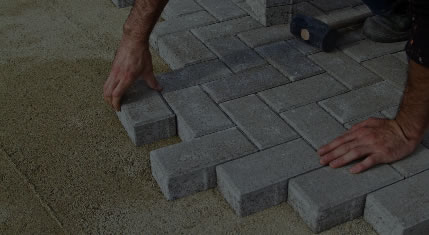 Worker creating a driveway