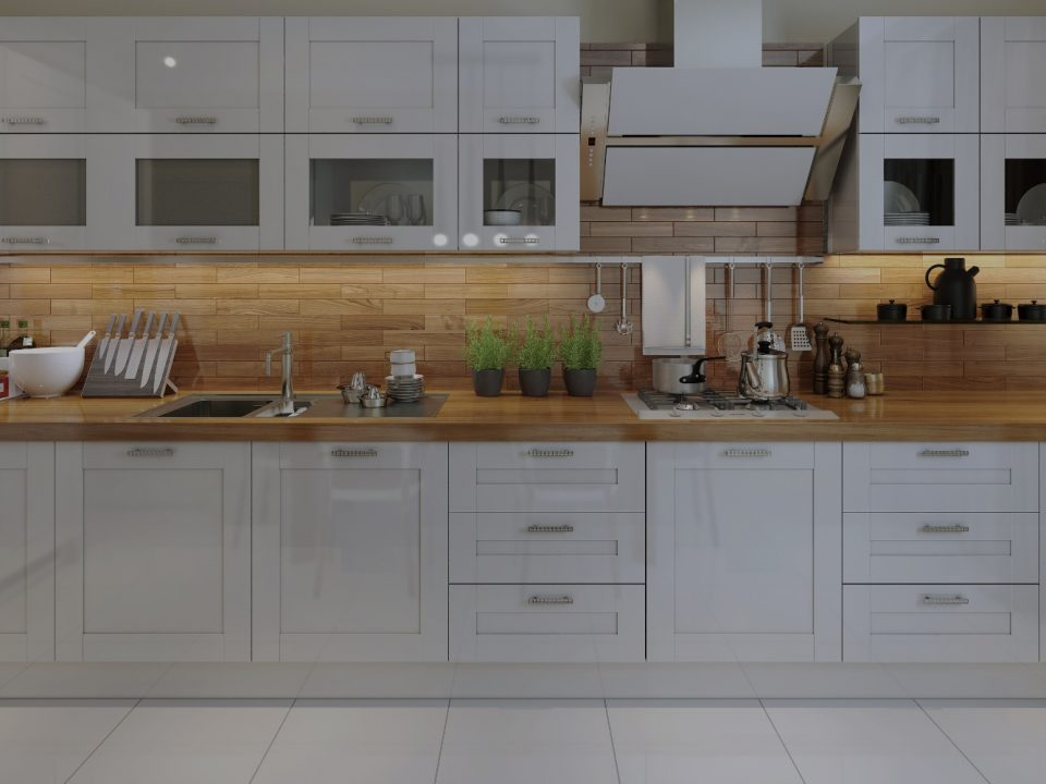 Luxury kitchen with white cabinets and wooden splashback